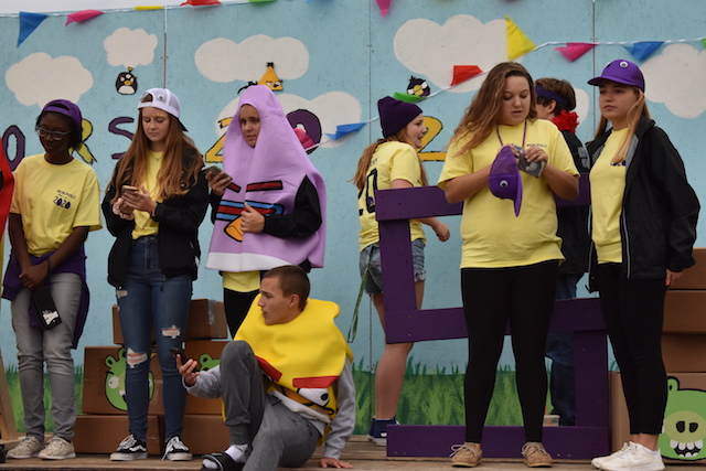 The Juniors hang out on their Angry Birds themed float at Menchville's annual Homecoming parade.