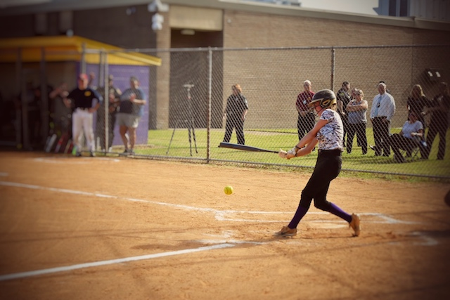 Stormi Nichols at home plate swinging her bat at Menchville's NNPD vs. Girls Softball game on 10-10-18