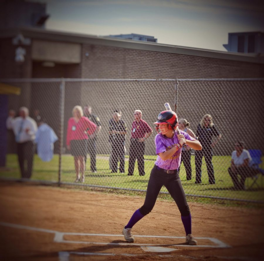 Josie Hartigan at home plate about to swing at the NNPD vs. Menchville's Girls Softball Game on 10-10-18.