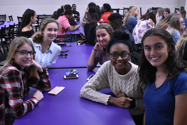 The girls cross country team smile for the camera at the fall sports banquet.