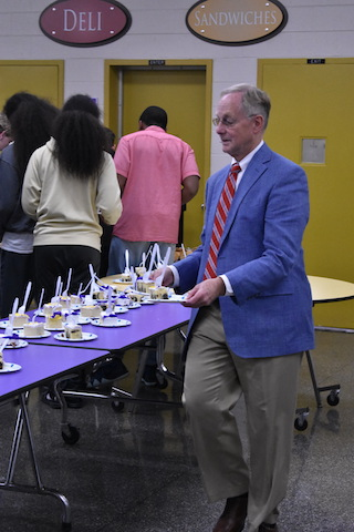 Mr. Surry serving cake at the Fall Sports Banquet.