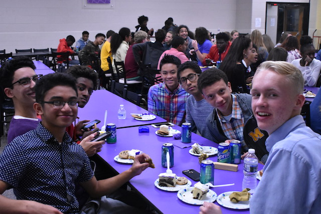 The boys cross country team enjoying some cake at the Fall Sports Banquet