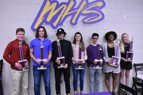 The awarded seniors standing with their trophies at the Fall Sports Banquet.