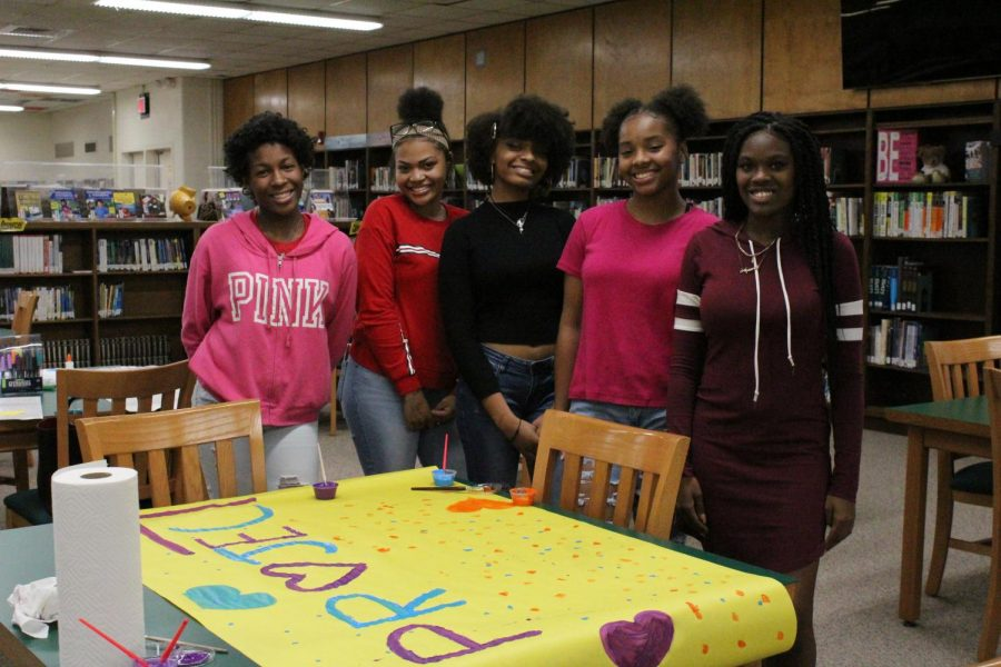 Jamie Coney, Kiara Thompson, Cyrah Mays, Paris Testman, and Myasha Parson create posters for Project Inclusion, who had their first club meeting this week.