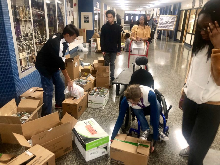 Lead2Feed students pack cans from the can collection into boxes