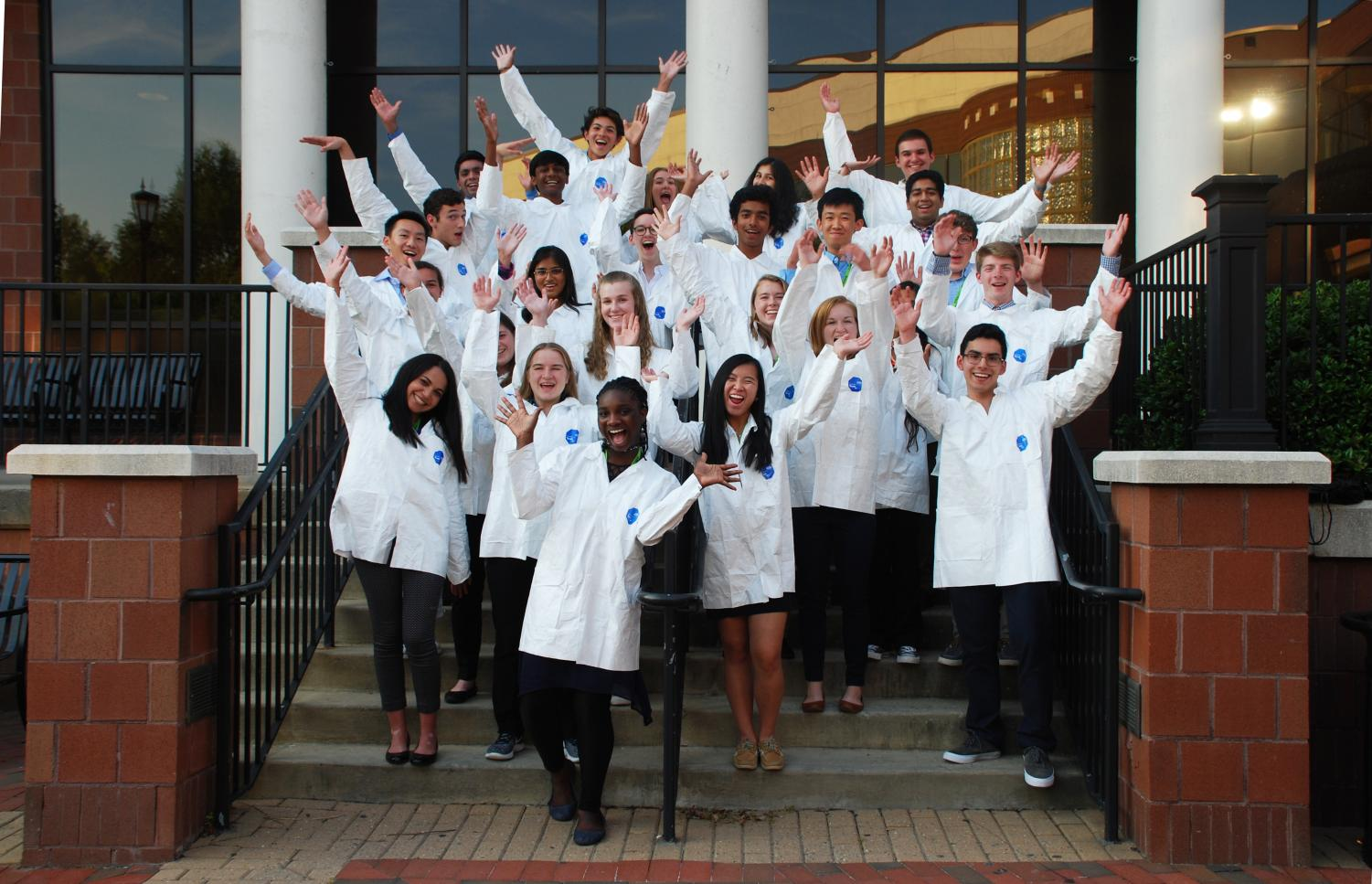 Students at the Governor's School for Medicine and Health Sciences are presented with a white lab coat after convocation.