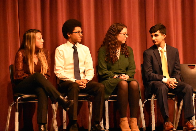 Four Honor Society inductees delivered speeches on the four main components of science: curiosity, failure, perseverance, and discovery.