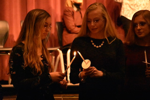 New members participated in the Society pledge and traditional candle lighting ceremony.