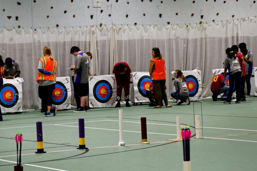 Archers scoring and pulling their arrows.