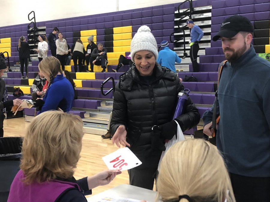 Vice Principle Michelle Banks signing up for the Winter Chill 5k