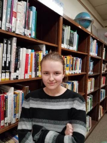 Hailey James poses for a portrait in the library.