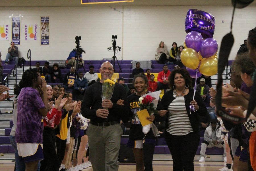 Senior Sydney Harris escorted by her Mother and Father