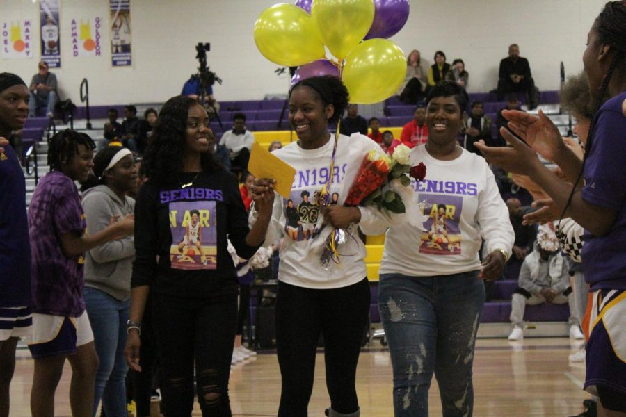 Senior Reagan Wilson escorted by her mother and sister.