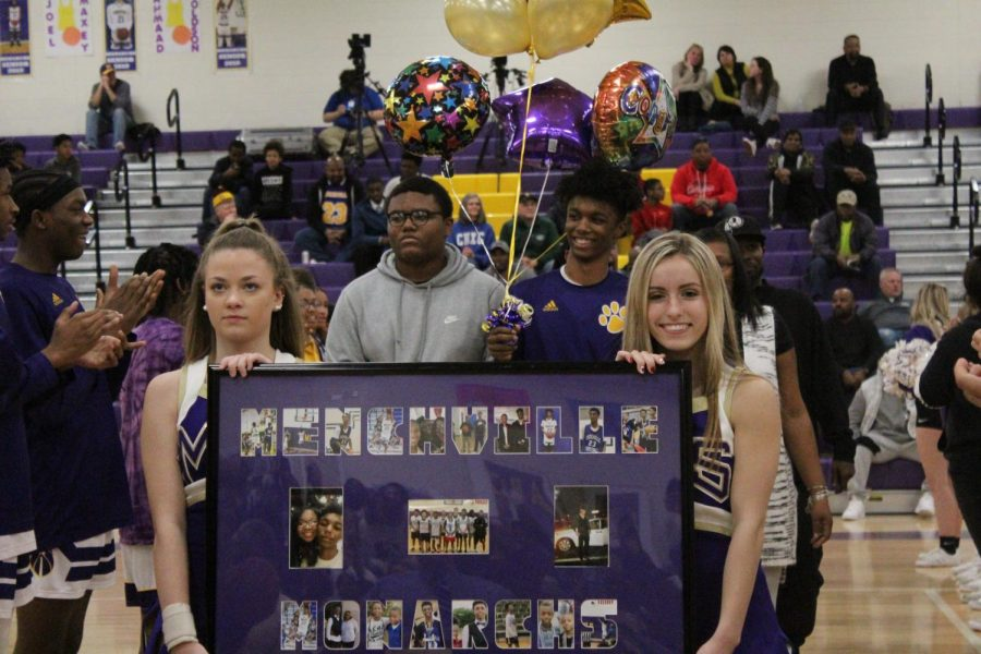 Amar Hawkins escorted by his family.