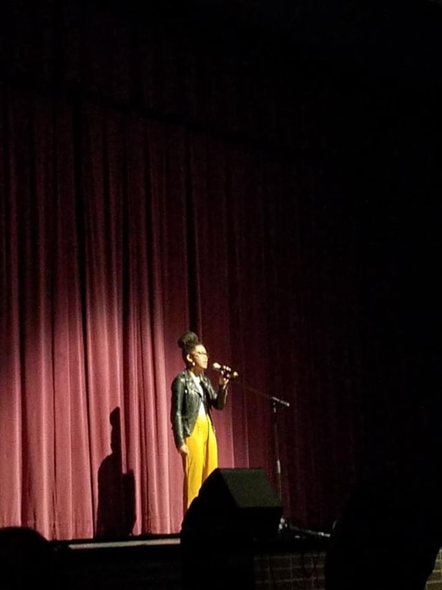 Kiki Carter singing an original song for the talent show.
