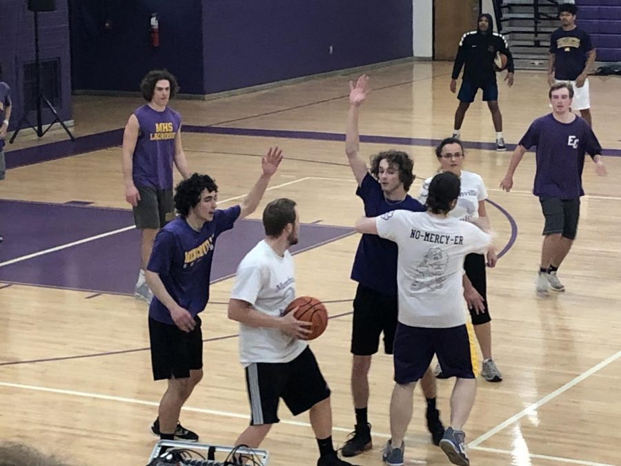 Seniors try to block the faculty team as they try to pass the ball