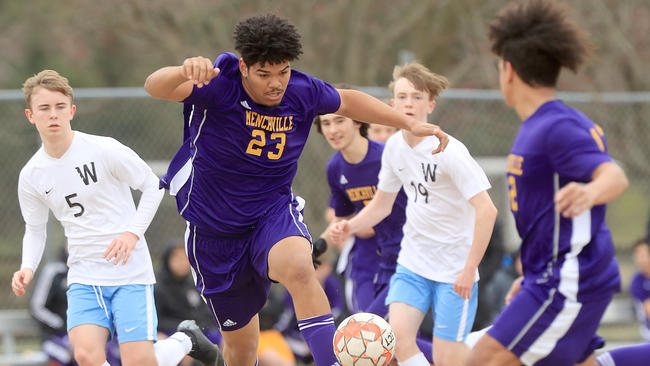 Menchville's Neeko Perez takes the ball upfield against Warhill during the first half Wednesday March 20, 2019 at Menchville.