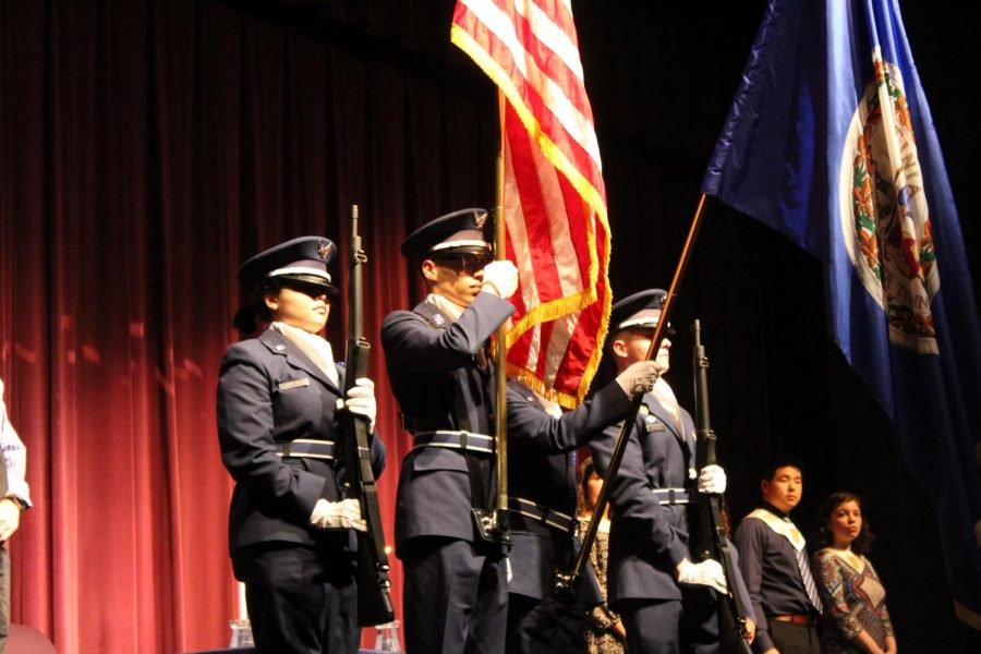 The+ceremony+began+with+ROTC+members+presenting+the+colors+for+the+Pledge+of+Allegiance.