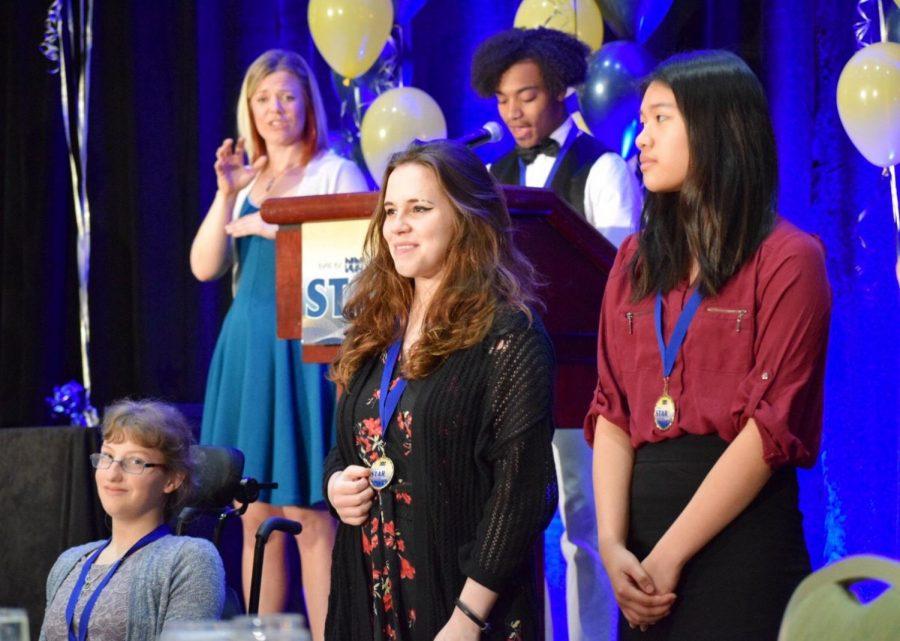 Beth Ellis, Sophia Ottofaro, and Melissa Zheng attended the STAR Awards to represent Menchville's Fare Share.