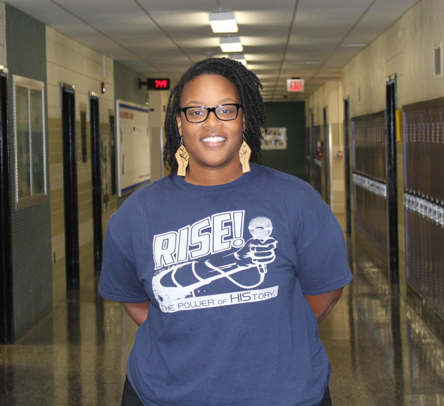 Director of Fooball Operations, Mrs. Graham, poses for a photo in the Menchville hall.