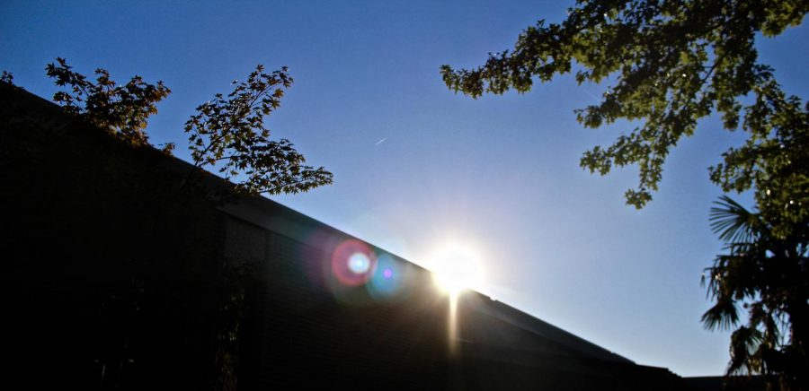 The sun rises over the edge of the roof- are we really here this early?