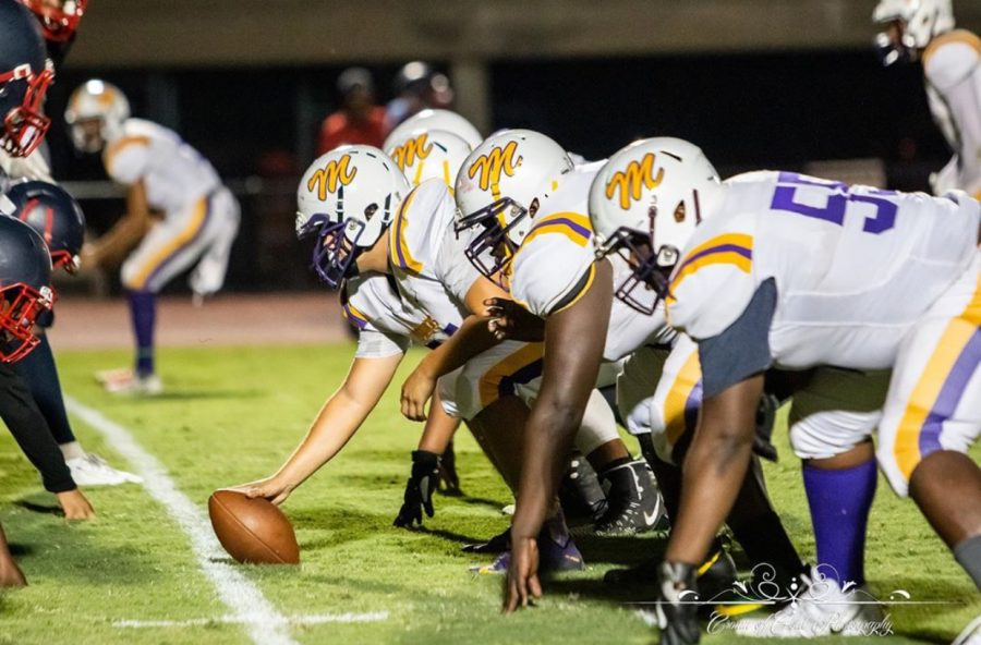 Menchville+Football+team+prepares+for+an+offensive+drive+against+Grafton.