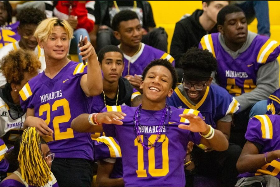 The hype for the homecoming game builds as Menchville football players dance during the pep rally.