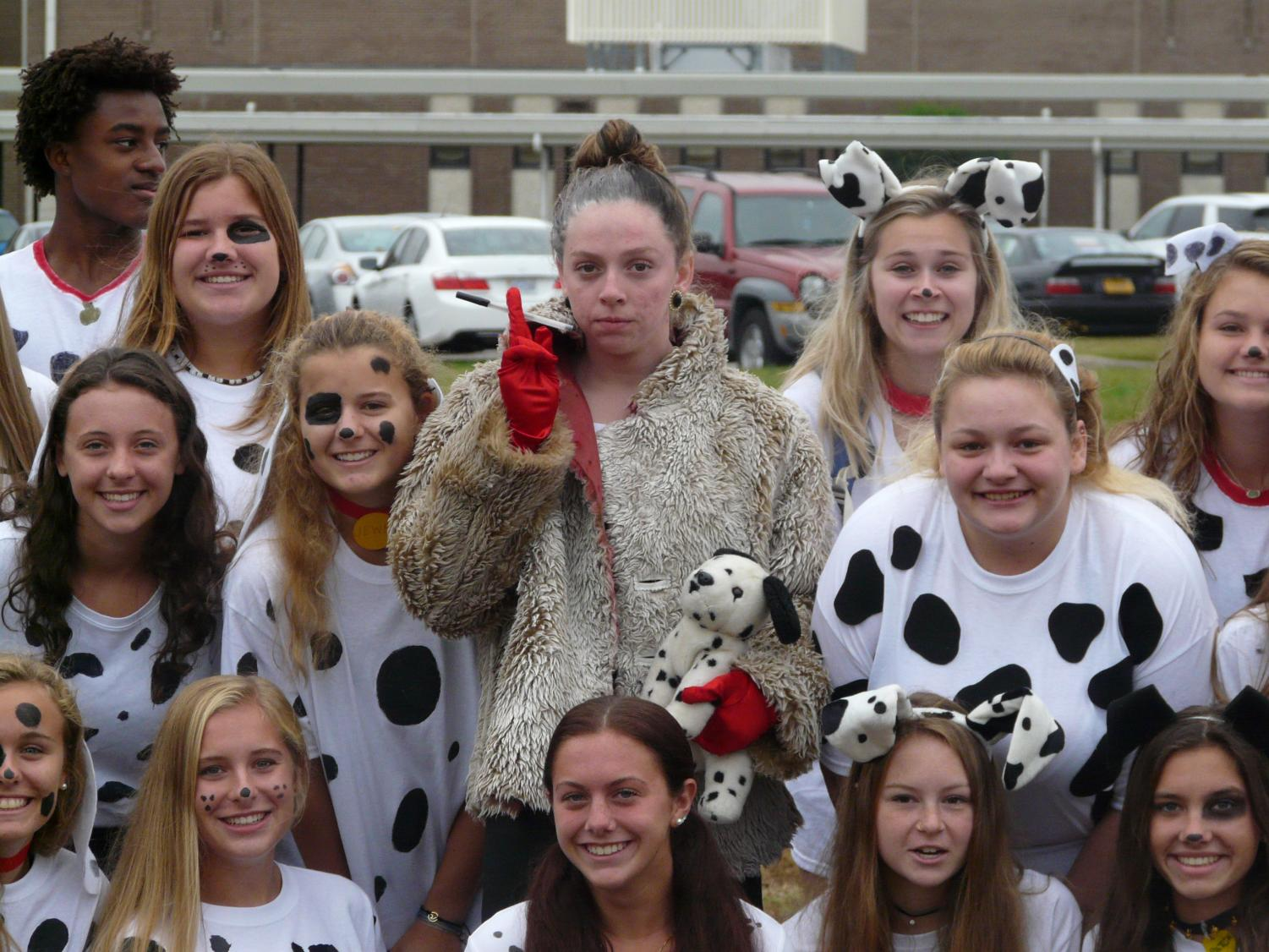 Delaney+Younger%2C+pictured+here+as+Cruella+de+Vil%2C+was+the+mastermind+behind+a+101+Dalmatians+costume-+with+101+Menchville+students+participating.