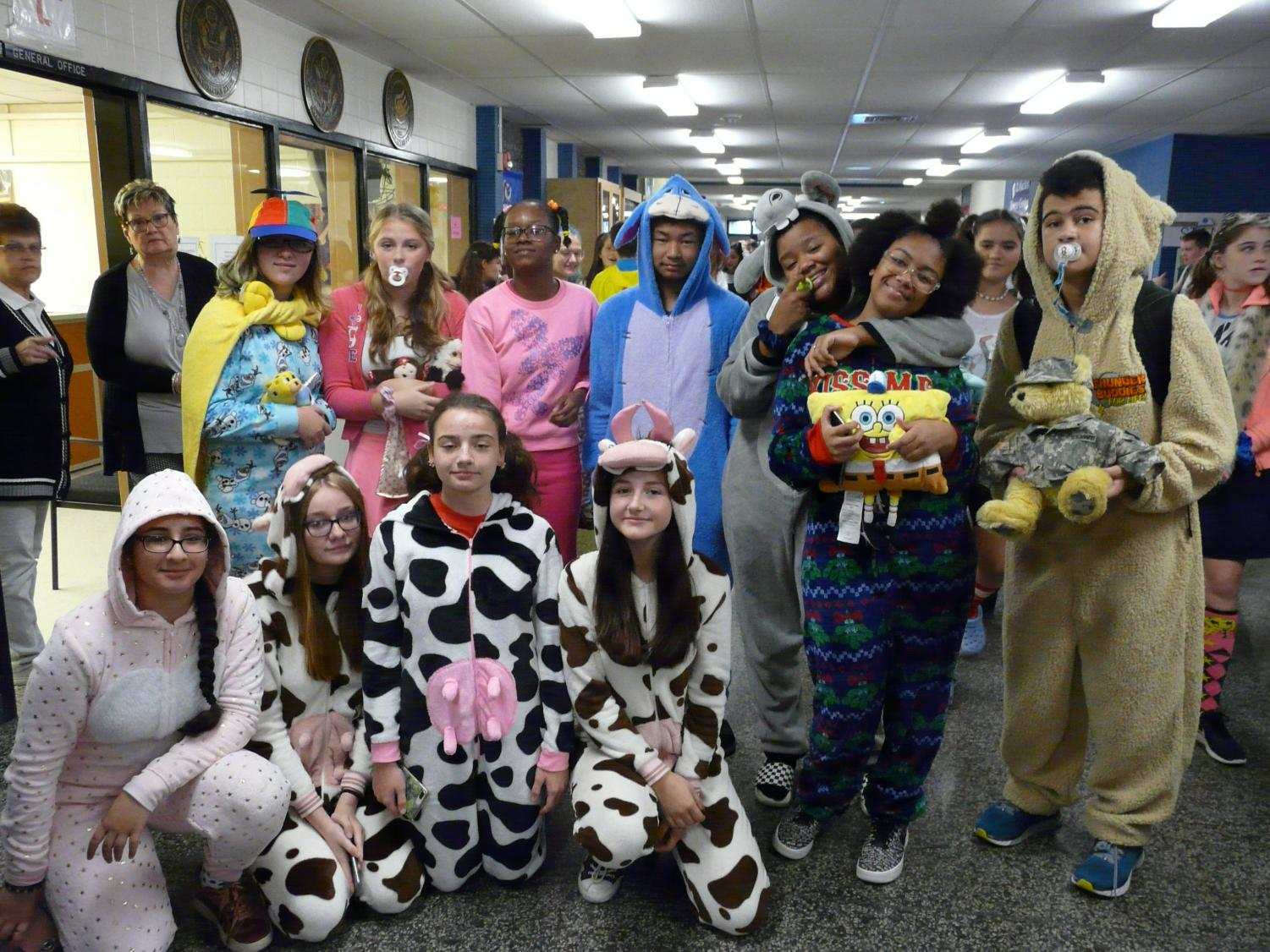 Freshman+had+to+dress+as+children%2C+sophomores+as+teens%2C+juniors+as+adults%2C+and+seniors+as%2C+well%2C+senior+citizens.+Pictured+here+are+some+of+our+naptime-ready+freshmen+in+onesies.