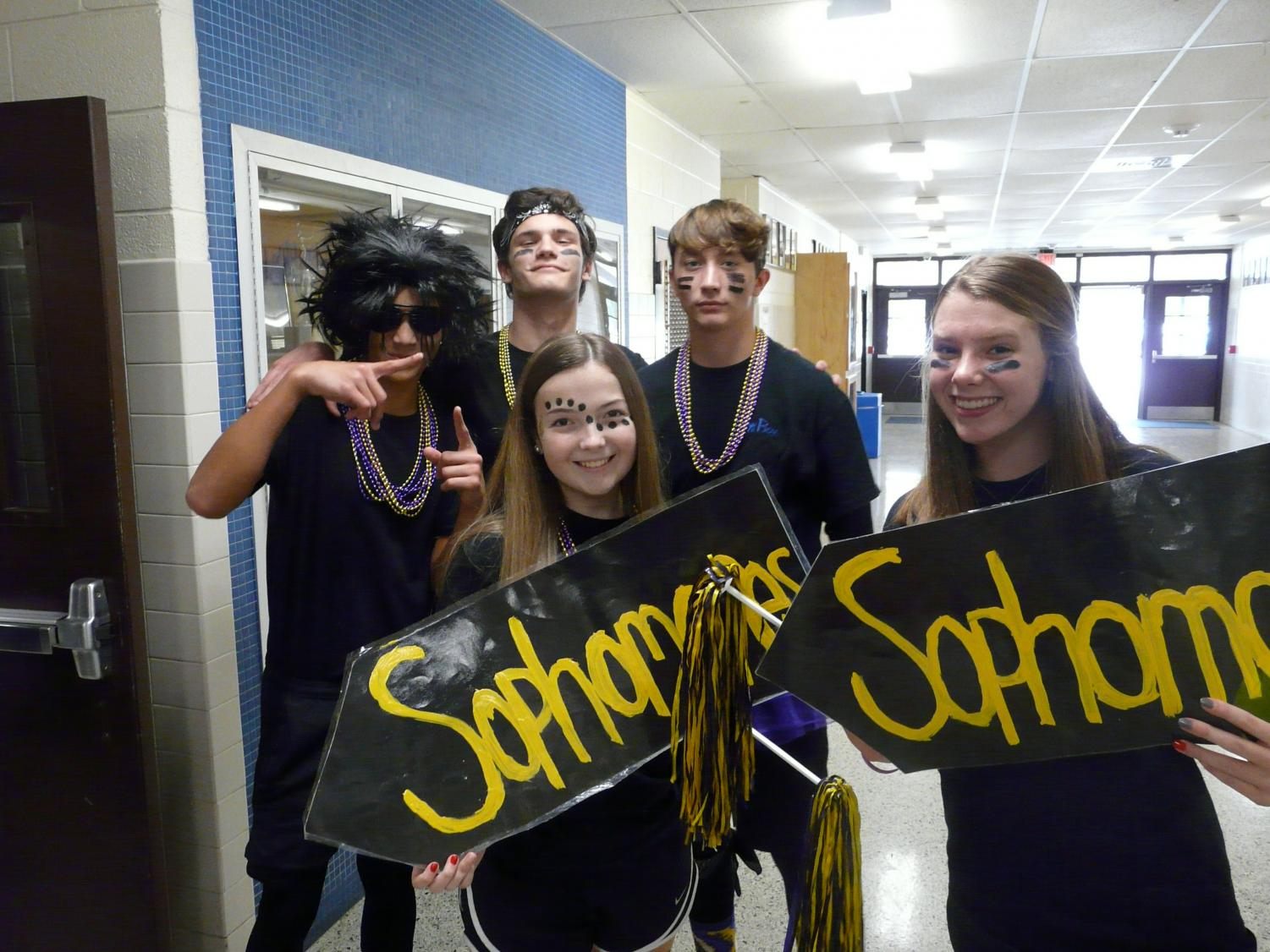 Sophomores+pose+with+their+class+signs.