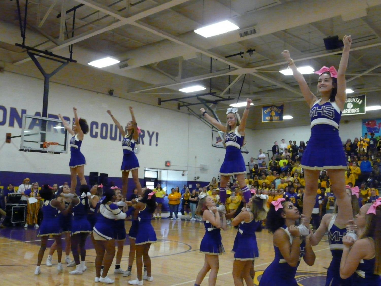 The+cheerleaders+performed+at+both+pep+rallies.