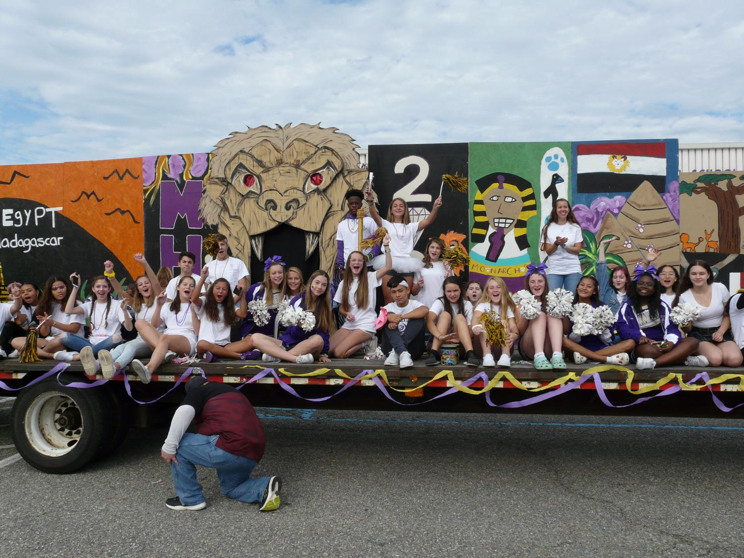Freshmen+crowd+the+float+and+prepare+for+the+parade.