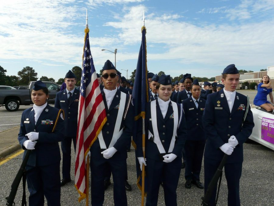 The Menchville ROTC carried flags to be presented at the Homecoming game.