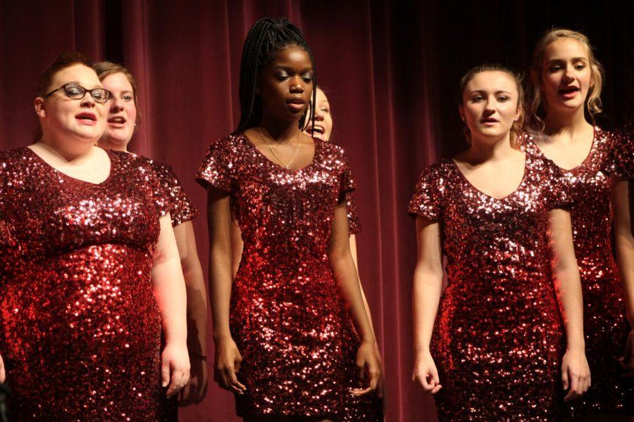 Jolies Voix Choir performs a song at their winter concert.