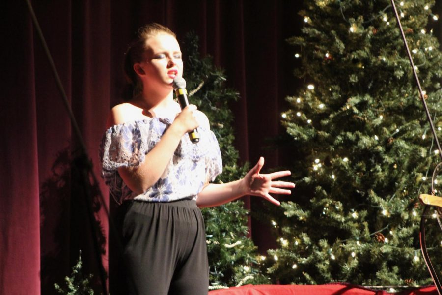 Sophomore Hailey James performs a solo at her choir's winter Christmas concert.