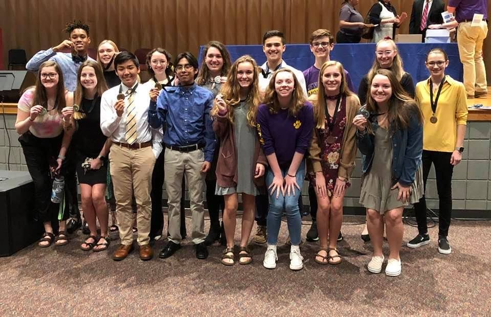 Some of the winning monarchs pose with their medals at the All-City Science Fair.