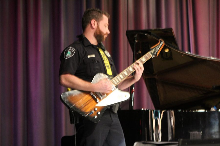 Monarchs know that Officer Wilder, the school resource officer, has a tendency to play guitar in the hallways. As an added surprise, he took his talents onstage for Menchville Rocks.
