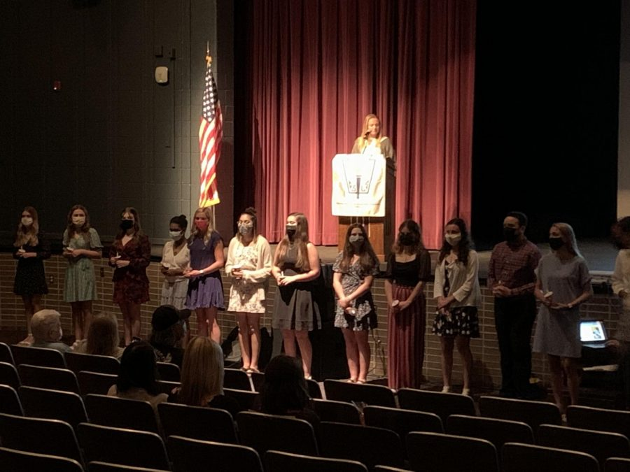NHS Officer Taylor Wadell introducing the names of the inductees.