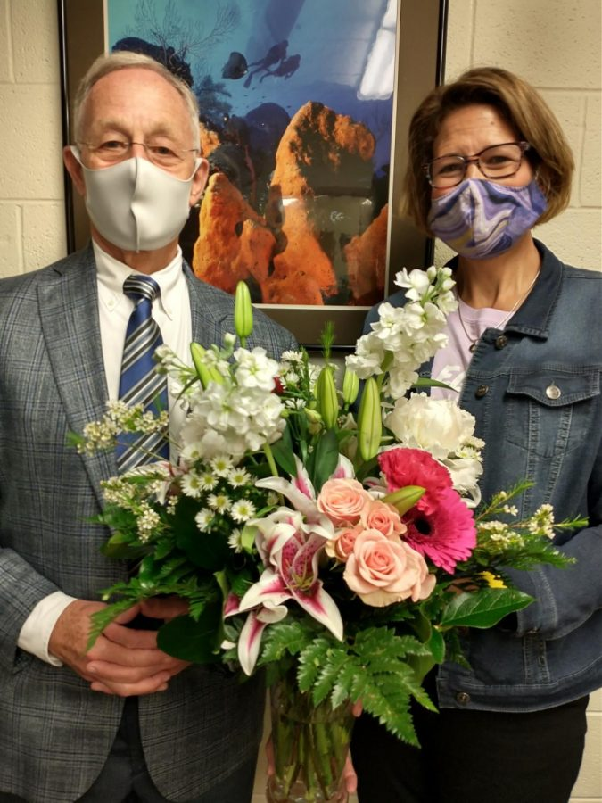 Newport News High School Teacher of the Year recieves congratulations from Principal Bobby Surry.